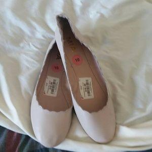 Beige slip on shoes